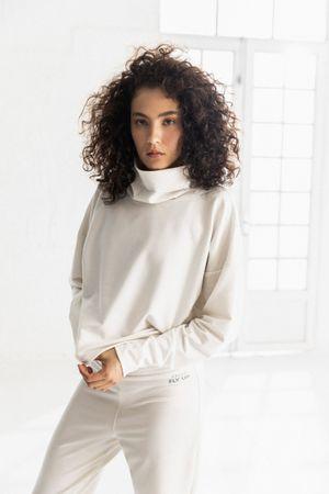 Blusa para mujer manga larga cuello alto Soft Crema